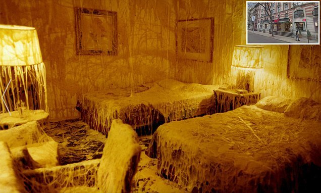 The time an artist used 1,000lbs of CHEESE to decorate a hotel room