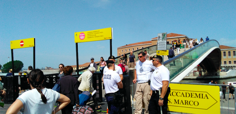 Venetians have torn down the new turnstiles separating locals from tourists