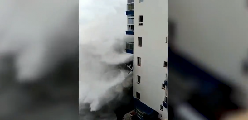 Tenerife apartment block battered by storm waves as heavy rain affects south eastern Spain