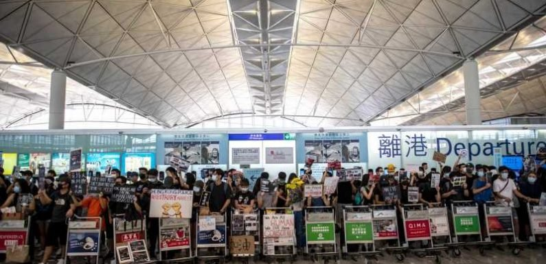 Protestors Storm Hong Kong International Airport, Causing Hundreds of Flight Delays and Cancellations