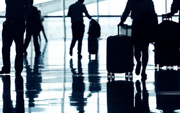 Airline baggage fees called 'excessive' after flyer was fined for carry-on