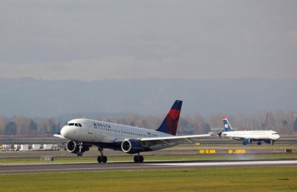 Icy Conditions Cause Delta Plane to Slide Off Taxiway