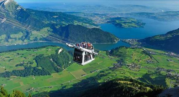 Daring tourists can stand on the roof of a cable car climbing a 6233ft mountain