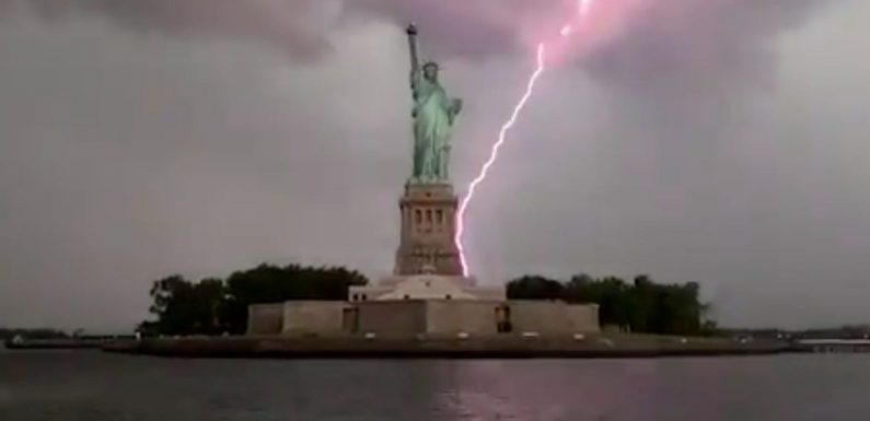 A stunning video shows the Statue of Liberty being struck by lightning