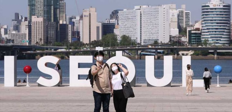 A musician who felt the US was unsafe went to South Korea. He posted about his 2-week mandatory quarantine on TikTok, but wouldn't encourage others to leave.