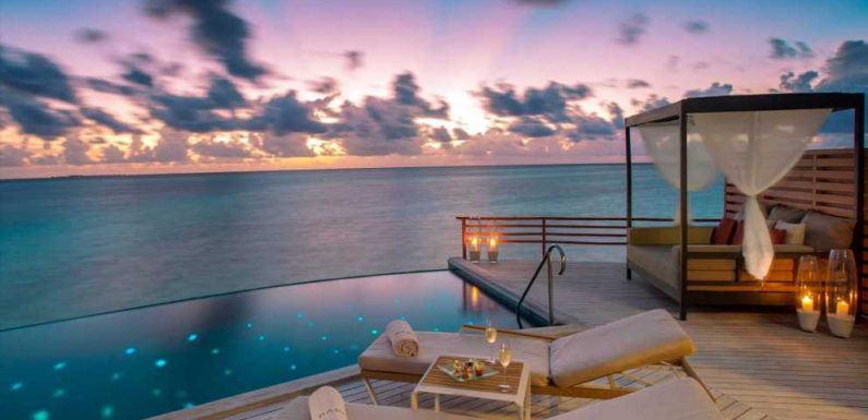 A private island resort in the Maldives has been named the world's best luxury hotel. Look inside the retreat, where guests sleep in villas that cost upwards of $1,500 per night.
