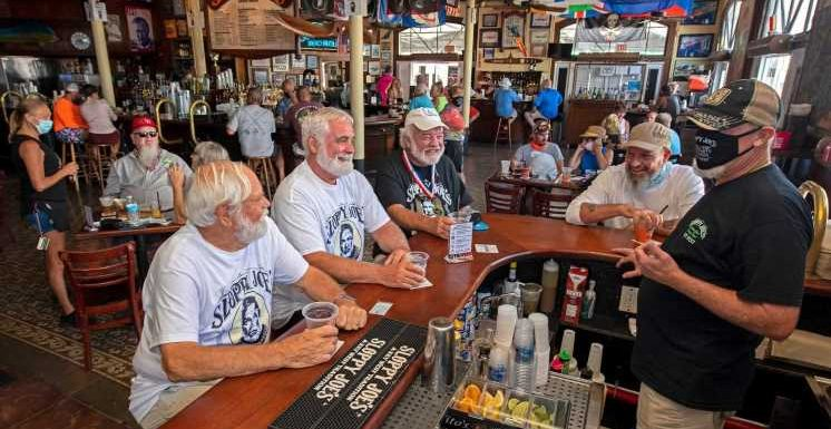 Ernest Hemingway lookalikes flock to iconic Key West, Florida, bar as it reopens