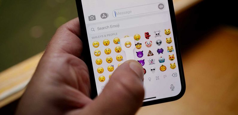 Apple's New Mask-wearing Emoji Is Smiling to Show Wearing a Mask Is Cool