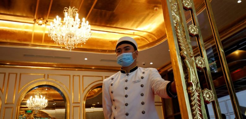 Inside world's first gold-plated hotel with bling walls, toilets and steaks