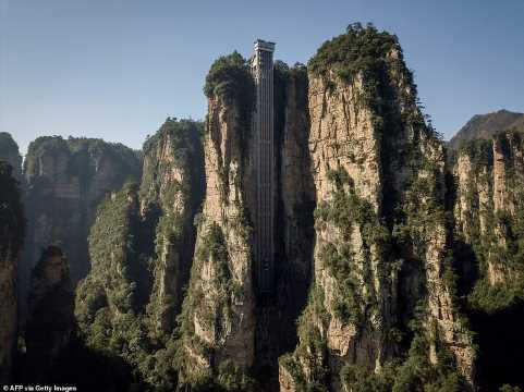 World's highest outdoor elevator zips tourists up China's Avatar cliff