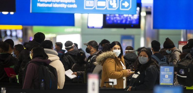 Travellers queue for up to four hours at Heathrow Airport