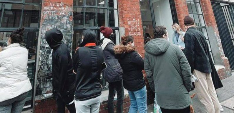 Dozens of masked Victorians queue for peculiar reason