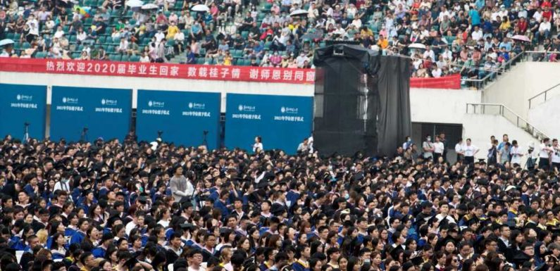 More than 11,000 Wuhan students poured into a stadium for their graduation ceremony sans masks or social distancing, even as the rest of Asia grapples with COVID lockdowns