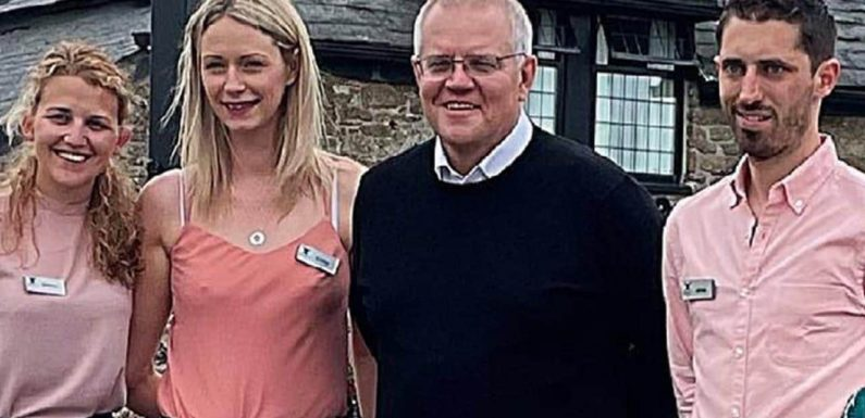 PM hits back after photo furore