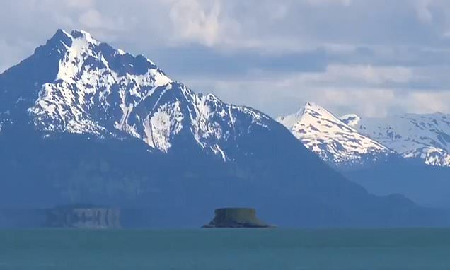 Illusion turns Alaskan island into flying saucer hovering above water